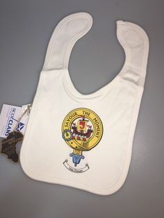Poly cotton baby bib with crest of clan Duncan. Soft feel fair trade sourced material.