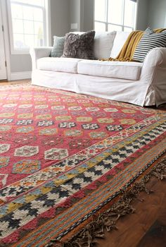 I'm showing you guys a sneak peek of my Living Room and talking about my favorite rug pad for hardwood floors. This rug pad will change your life!