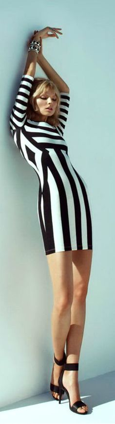 Dress with black & white stripes. Might as well be a zebra, who knows for sure.
