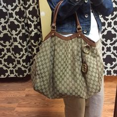 "Gucci Brown monogrammed ""Sukey""handbag. Heavy wear on backside. Shown in second pic. Frontside has small wear shown in 4th pic. Still a nice large everyday bag. Inside is clean. Gucci Bags"