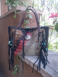 The DIANE: Navajo Handbags made from blankets / rugs, vintage horse tack, and deer, elk or cowhide leathers. I embellish the bags with vintage trade beads, turquoise, coral, nickel silver/German silver Concho buttons, nickel silver spots/studs, and deer antler tips.