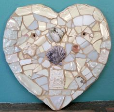 Heart mosaic hand made from shards cut to fit of vintage plates and tiles. .Hand made, hand painted clay pieces and glass marble, stone in a