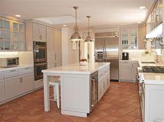 Contemporary Kitchen with terracotta tile floors, Terra cotta sealed super saltillo tile, Pendant Light, Glass panel, Flush