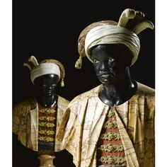 A pair of Italian gilt-bronze-mounted marble busts of blackamoors, Venetian, 18th century, on gilt-bronze-mounted brass and tortoiseshell inlaid première-and contre-partie boulle marquetry ebony veneered pedestals stamped N. P. Severin, Régence, circa 1715, 18th century.