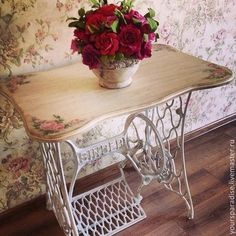 Love this! The base of a vintage sewing machine with a curvy top with pink roses painted on each corner! ~ So sweet!