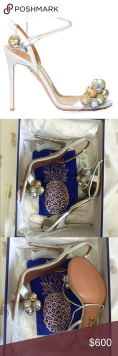 Brand New Aquazzura disco thing sandals 👠 Brand New !!! Never been worn. Got something else i loved more. Sparkly silver and gold pom pom sandals. Size 8 fits a true 8. Heel height just a little over 4 inches, still very easy to walk in. Comes with new box and dust bag! P.S not interested in trades. Aquazzura Shoes Sandals