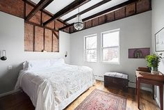 Williamsburg, Brooklyn, Gets Its First Bed and Breakfast-pretty oriental rug at the foot of the bed.