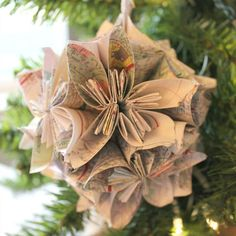 Consider this folded flower ornament the perfect decoration for those regularly bitten by the travel bug.  Get the tutorial at Chic California.