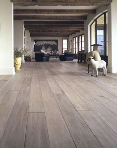 White washed hardwood floor and rustic beams - Love this color! <3 JH