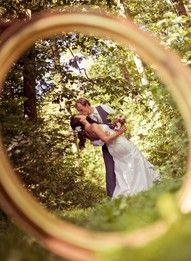 a wedding picture through the ring! Kinda cool if done tastefully.