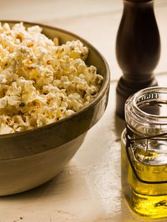 """Olive Oil Popcorn from Chef Michael Smith. Must do this for myself so I can stop asking Chris to make """"his"""" popcorn for me. Yummy Snacks, Healthy Dinner Recipes, Healthy Snacks, Snack Recipes, Olives, Crockpot Recipes, Cooking Recipes, Budget Recipes, Chef Michael Smith"""