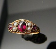 ANTIQUE VICTORIAN 9CT GOLD RING , GARNETS & SEED PEARLS 1899 PENDLETON & SON | eBay Antique Rings, Antique Jewelry, Seed Pearl Ring, Eternity Rings, Victorian Gold, Gold Brooches, Garnet Rings, Gold Platinum, Pearl Jewelry