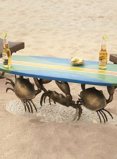 Standing on a sandy beach, our one-of-a-kind Crab Surfboard Table adds a touch of fanciful flair to your décor.