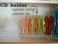 A CD Rack Repurposed Home Organizers - Home Organizing Hacks and Ideas - Good Housekeeping Organisation Hacks, Organizing Hacks, Organizing Your Home, Kitchen Organization, Storage Organization, Storage Ideas, Organize Plastic Containers, Storage Containers, Tupperware Organizing