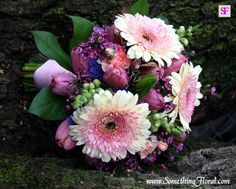 Pink, purple, and green bridal bouquet of gerbera daisies, tulips, carnations, snapdragons, and more. Designed by Something Floral / Something Spectacular, Warren, MI. Photo: Urban Fire Studio. #wedding #flowers