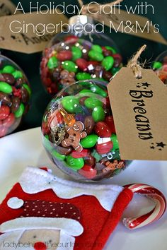 """This Holiday Decorating Idea with Gingerbread M&M's has THREE functions. First, it serves as a place card for a kid's Christmas table then it's a """"find it"""" game and finally it's a Gingerbread M&M filled ornament. Christmas Crafts For Kids, Christmas Deco, Christmas Goodies, Christmas Projects, Winter Christmas, All Things Christmas, Holiday Crafts, Holiday Fun, Christmas Holidays"""