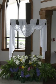 Church foyer: fern=home,hyacinth(blue)=constancy,palm=victory,daffodil=sacrifice,tulip=rebirth,lily(white)=majesty