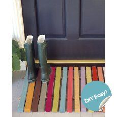 I would use this as a boot & shoe drying pad rather than a door mat because there's really nothing to wipe muddy or wet feet on.  Cute idea to paint the pieces... Would also make a cute pin or magnet board if sprayed with magnet paint.  SO MANY THINGS TO DO WITH PALLETS!!