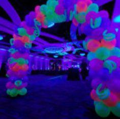 Glow in the dark balloon arch. Glows under black light!