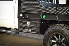 2015 Ford Aluminum Flatbed in Leopard style (hpi black w/ shaved diamonds) with matching underbody boxes, mud flaps, and an over cab tire rack. Custom Flatbed, Custom Truck Beds, Custom Trucks, Truck Flatbeds, Shop Truck, Hunting Truck, Tire Rack, Flatbed Trailer, Car Mods
