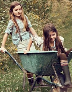 Girls in a wheelbarrow ~ England