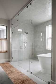 In lieu of traditional bathroom decor (like colorful bath mats or a thriving plant) we're encouraged to take a different approach, such as highlighting the architectural elements of a room. To help you get started we compiled a shortlist of the minimalist shower ideas you need on your radar. #hunkerhome #minimalist #showerideas #minimalistshowerideas #bathroom Oak, Grey Countertops, Minimalist Showers, Traditional Bathroom, Traditional Bathroom Decor, Minimalist Bathroom Design, Interior, Bathroom Design, Minimalist