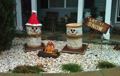 My outdoor Christmas decor-made smores snowmen by campire out of collapsible clothes hampers, foam flooring squares, & scraps