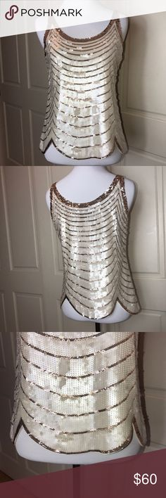 BCBGMaxAzria - Sequin Ivory and Gold Top Absolutely stunning sleeveless tank style top by BCBGMaxAzria. Features sequin detail in ivory and gold throughout. This is an absolutely stunning statement piece to add to your wardrobe. Adds just the right amount of zing to any date night ensemble! Size XS worn once, in excellent overall condition! 100% silk with a poly lining. The scallop detail at the hem makes this incredibly unique. BCBGMaxAzria Tops
