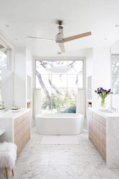 dreamy bath kathy kuo home //different fan and just marble sinks but I love that giant window and the tub
