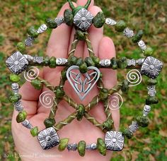 Handcrafted wood and wire with peridot stone beads, silver color metal beads, and handmade pewter Celtic knot heart pendant by Treasure Cast The Dance at Alder Cove
