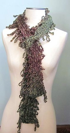 Shag scarves. I sold a big stack of these this year for the holidays.      It's knit on a loom.