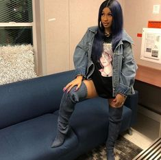 Get Cardi B's last pre-baby performance look from the Brocolli Festival in Washington DC #CardiBStyle #CardiBFashion #CelebStyle #CelebFashion #boots #Oversizedshirts #Denim #AcidWashedDenim #