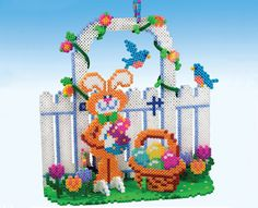 Create this fun 3-D scene in anticipation of the Easter Bunny delivering his eggs. This is a great family project with lots of colorful pieces and makes a festive decoration for your Easter table!
