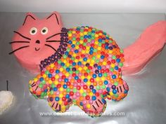 Homemade Cat Cake: I made two different sized circle cakes for this Cat Cake. One for the head and one for the body. I used a sponge to cut out the tail, ears and feet. To