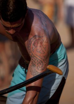 Tattooed man ready for a canoe competition at Anakena beach, Easter Island, Chile. Photo by Eric Lafforgue.