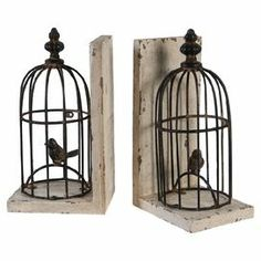 "The perfect accent to your home library or office, this rustic-chic bookend showcases a weathered white finish and metal birdcage silhouette.   Product: Set of 2 bookendsConstruction Material: Metal and woodColor: Weathered white and brownFeatures: Birdcage silhouetteDimensions: 9.8"" H x 5.5"" W x 4.3"" D (each)"