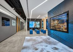 Spacewell Interiors has completed the design of Ingram Micro's new split level offices, a technology company, located in Dubai, United Arab Emirates. Experience Center, Waiting Area, Video Wall, Workplace Design, Interior Photography, Wooden Puzzles, Branding, Stone Tiles, Office Interiors