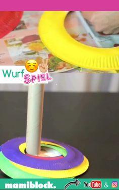 DIY Wurfspiel selbst basteln: Das Spiel aus bunten Papptellern ist ganz schnell und leicht gemacht - und das mit wenigen Materialien. Das ganze Video, noch mehr Tipps, Tricks und Infos findest du auf dem YouTube Kanal von mamiblock.