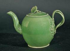 An English Green-glazed Creamware Teapot, circa 1785.