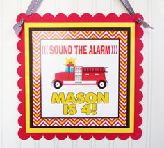 "Greet your party guests with our Personalized Fire Truck Door Sign! Our sign is laser printed and made with several layers of quality coordinating card stock. Sign measures approximately 11.5"" x 11.5"""