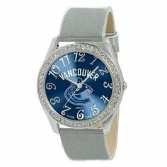 Vancouver Canucks Ladies Watch - Designer Diamond Watch by Game Time. $39.95. 50 Crystal Stones-Water Resistant Up To 3 ATM. Stainless Steel And Leather. Women. Approximately 1 Inch Face. Officially Licensed Vancouver Canucks Ladies Designer Diamond Watch. Vancouver Canucks women's watch. This Canucks designer diamond watch features a metal case with 50 crystal stones. The watch is made of a patent leather strap, brass dial, stainless steel buckle, case back and crown. Jap...