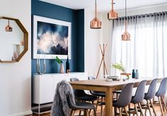 Home to a boisterous and energetic family of five, this abode recently underwent a dramatic transformation to become warm, contemporary and full of laughter. Blue And Copper Living Room, Copper Dining Room, Navy Living Rooms, Dining Room Blue, Dining Room Design, Dining Rooms, Dining Area, Dining Room Feature Wall, Tv Rooms
