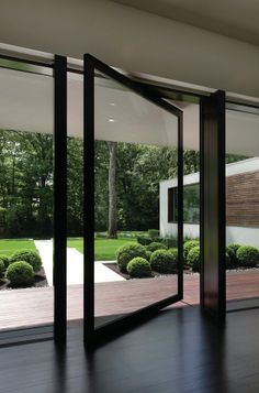 Pivot doors assist in the blending of interior and exterior.