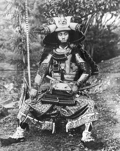 Man in a full samurai armor - probably actor or cosplayer (NOT Mifune for sure as many suggested)