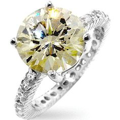 Genuine Rhodium Plated to Sterling Silver Classic Engagement Style with Pave Cubic Zirconia Band Polished into a Lustrous Silvertone FinishThis engagement ring is set to sparkle with a large 10 mm cubic zirconia center piece and embellished w. Engagement Ring Sizes, Diamond Engagement Rings, Solitaire Ring, Lily Jewelry, Jewelry Box, Jewlery, Canary Diamond, Fire Ring, Stone Rings
