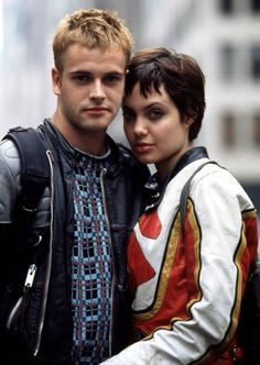 """Angelina Jolie married her first husband, Jonny Lee Miller, after the two worked on """"Hackers."""" When they wed on March 28, 1996, she wore black rubber pants with Miller's name written in blood. However, things with Miller cooled by 1997, and the two separated in September. (Photo from """"Hackers"""",1995)"""