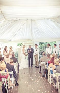 Wedding ceremony in a tent outdoors | Vintage wedding photography | www.newvintagemedia.ca