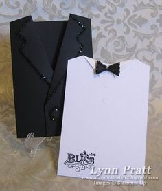 handmade card ... tuxedo pocket card ... open ... the shirt piece tucks into the jacket ... glitzy theme with glitter on edges ... very clever ...