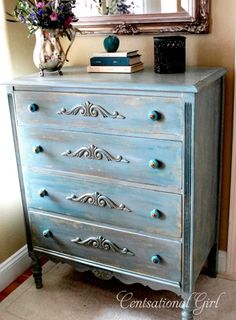 So much can be done with appliqués and new knobs to give a piece a new look !   Sources for materials: dresser from Craigslist; appliqués from Lowes;  Pratt & Lambert paint and Minwax Polycrylic from OSH; knobs from Anthropologie.