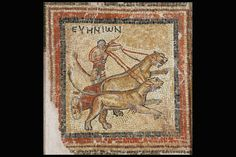 """Part of a mosaic floor from a villa, with a hunting scene. It depicts a chariot drawn by panthers, a theme possibly related to the worship of Dionysus or the mysteries of Andania, with which the name EYHNIΩN  (""""exceptional charioteer"""") is also related.   Desyllas.  5th c. A.D."""